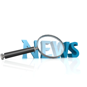 Magnifying glass with blue news word